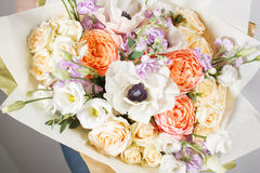 Florist at work. Make rich bouquet diferent color and flowers. Bunch in their hands Stock Image