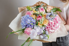 Florist at work. Make Serenity hydrangea rich bouquet. flowers in their hands Royalty Free Stock Image