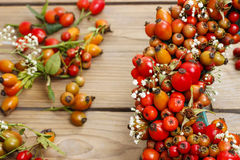Florist at work: rose hip and hawthorn door wreath Royalty Free Stock Photo