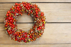 Florist at work: rose hip and hawthorn door wreath Royalty Free Stock Images