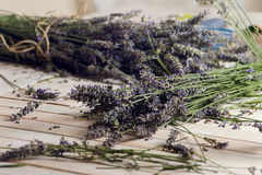 Florist at work: woman creating bouquet of natural lavender flow Royalty Free Stock Images