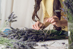 Florist at work: woman creating bouquet of natural lavender flow Stock Photography