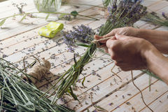 Florist at work: woman creating bouquet of natural lavender flow Stock Photo
