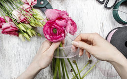 Florist at work Stock Images