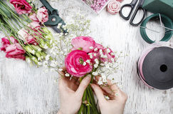 Florist at work. Woman making beautiful bouquet Royalty Free Stock Photo