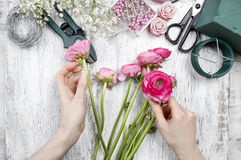 Florist at work. Woman making beautiful bouquet Stock Photos