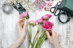 Florist at work. Woman making beautiful bouquet Stock Photos