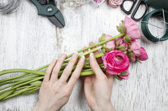 Florist at work. Woman making beautiful bouquet Royalty Free Stock Images