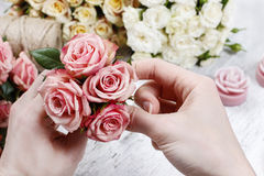 Florist at work. Woman making bouquet of pink roses Royalty Free Stock Photos