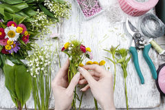 Florist at work. Woman making bouquet of wild flowers Royalty Free Stock Photo
