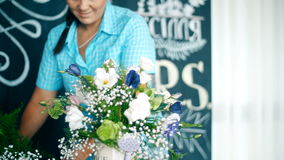 Florist at work: woman making fashion modern bouquet of different flowers stock video