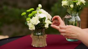 Florist at work: woman making fashion modern bouquet of white rose. stock video footage