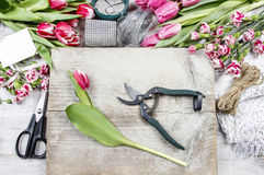 Florist at work. Woman making floral decorations. Florist at work. Woman making spring floral decorations Royalty Free Stock Images