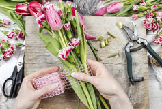 Florist at work. Woman making floral decorations Royalty Free Stock Image
