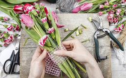 Florist at work. Woman making floral decorations Royalty Free Stock Photo