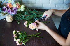Florist at work. Woman making spring floral decorations Royalty Free Stock Photo