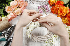 Florist at work. Woman making summer floral decorations Stock Images