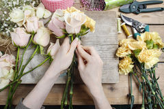 Florist at work. Woman making wedding bouquet Royalty Free Stock Image