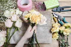 Florist at work. Woman making wedding bouquet Stock Photography