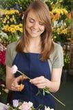 Florist Working On Flower Arrangement In Shop Stock Image