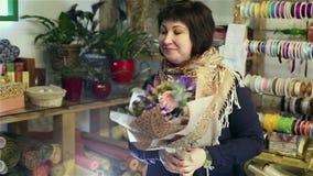 Florist is working in flower salon. stock video