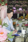 Florist Working In Flower Shop Royalty Free Stock Photography
