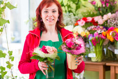 Florist working in flower shop Royalty Free Stock Image