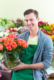 Florist working in flower shop Stock Image
