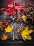 Florist workplace with autumn leafs and vintage shears Stock Image