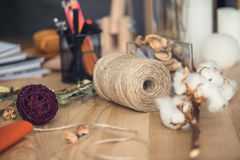 Florist workplace with dry cotton flowers Stock Photos