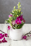 Florist workplace: Floral arrangement with orchid flowers and gy Royalty Free Stock Photography
