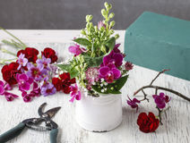 Florist workplace: Floral arrangement with orchid flowers and gy Stock Photography