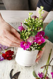 Florist workplace: Floral arrangement with orchid flowers and gy Royalty Free Stock Photo