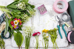 Florist workplace: flowers and accessories Stock Photos