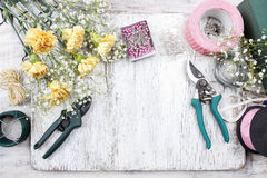 Florist workplace: flowers and accessories Royalty Free Stock Images