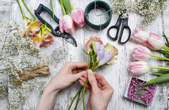 Florist workplace: flowers and accessories stock image