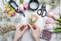 Florist workplace: flowers and accessories Royalty Free Stock Image