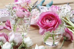 Florist workplace: incomplete tiny bouquets Stock Photo