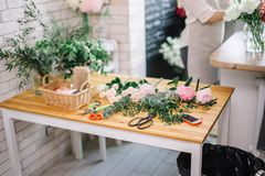 Florist workplace with summer flowers and accessories Stock Photos