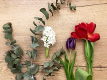 Florist workplace. Top view. Flowers on a old wooden table. stock photos