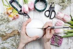 Florist workplace: woman making floral arrangements Stock Photos