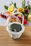 Florist workspace: how to make floral arrangement with roses in. Wicker basket. Step by step, tutorial royalty free stock images