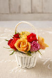 Florist workspace: how to make floral arrangement with roses in. Wicker basket. Step by step, tutorial Stock Photos