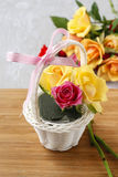 Florist workspace: how to make floral arrangement with roses in. Wicker basket. Step by step, tutorial stock photo