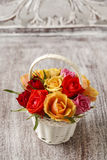 Florist workspace: how to make floral arrangement with roses in. Wicker basket. Step by step, tutorial Royalty Free Stock Photos