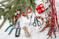 Florist workspace: woman making floral decorations. For christmas Royalty Free Stock Photo