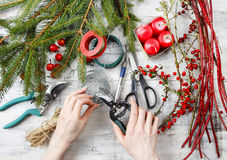 Florist workspace: woman making floral decorations. For christmas Stock Image
