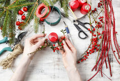 Florist workspace: woman making floral decorations. For christmas Royalty Free Stock Images