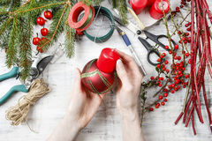 Florist workspace: woman making floral decorations. For christmas Royalty Free Stock Photography