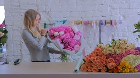 Florist wraps flowers in gift paper at flower shop stock footage florist wraps flowers in gift paper at flower shop mightylinksfo
